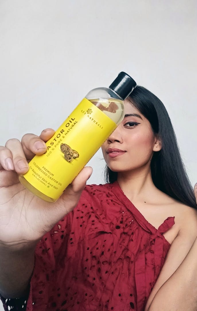 Hair,Skin,Beauty,Product,Yellow,Lip,Long hair,Black hair,Material property,Hand
