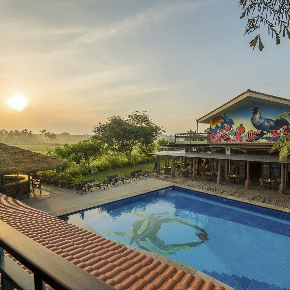 Swimming pool,Property,Resort,Real estate,Sun,Composite material,Resort town,Astronomical object,Sunrise,Eco hotel