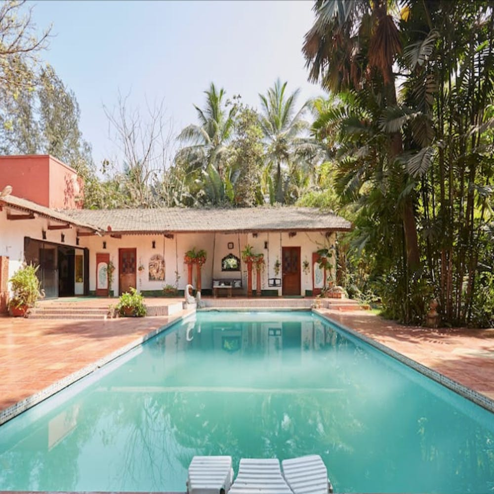 Swimming pool,Property,Real estate,Resort,House,Residential area,Villa,Home,Composite material,Arecales