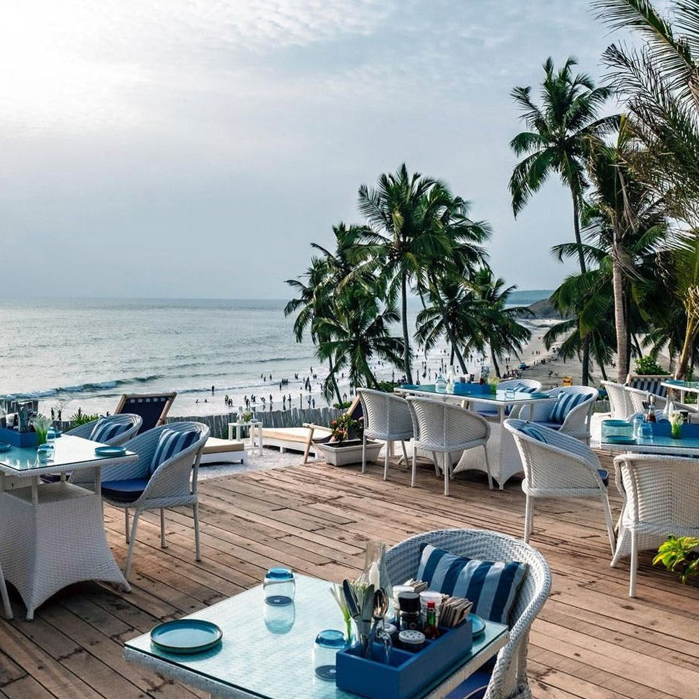 Outdoor furniture,Furniture,Coastal and oceanic landforms,Resort,Table,Ocean,Turquoise,Teal,Beach,Azure