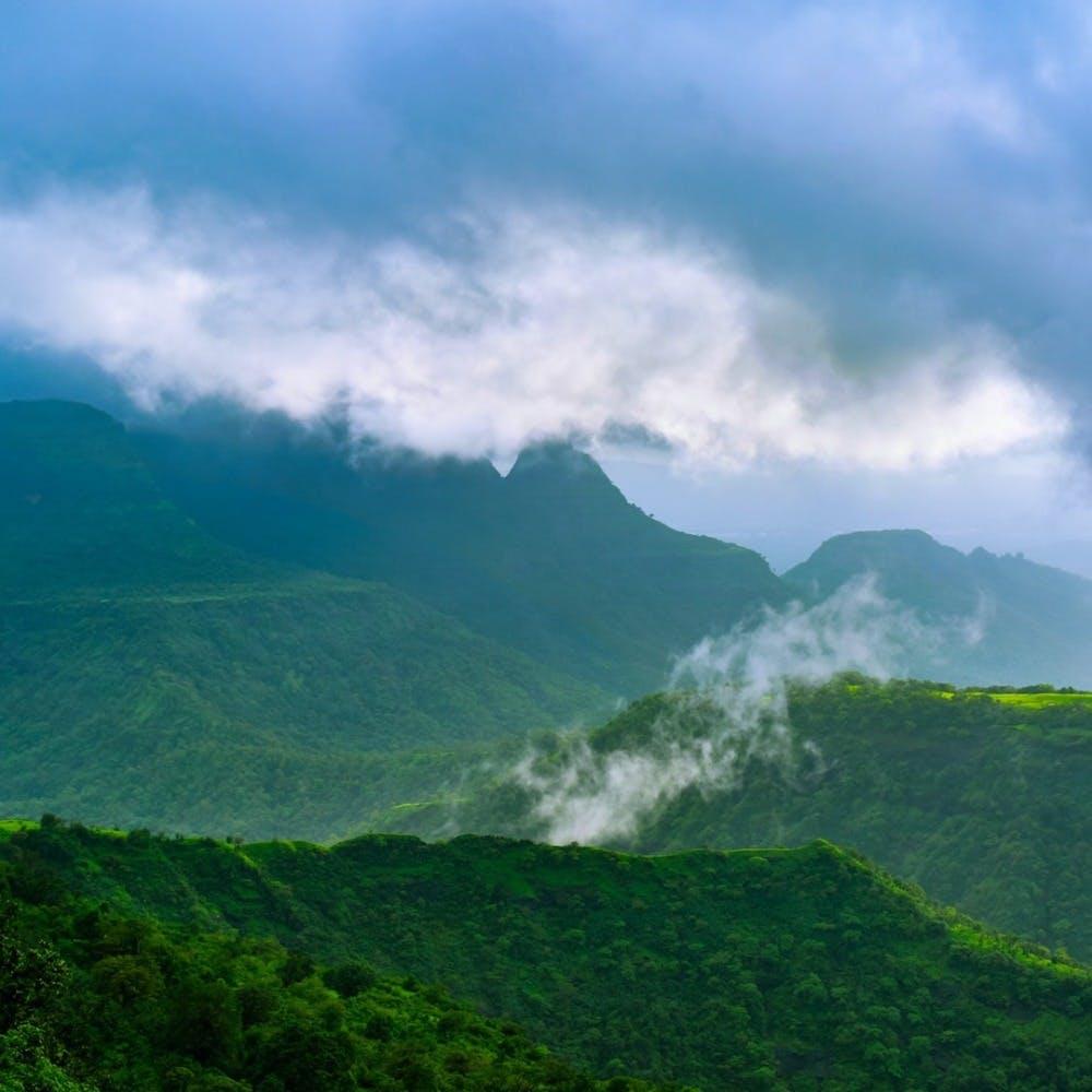 Mountainous landforms,Green,Sky,Highland,Cloud,Hill,Mountain range,Mountain,Valley,Hill station