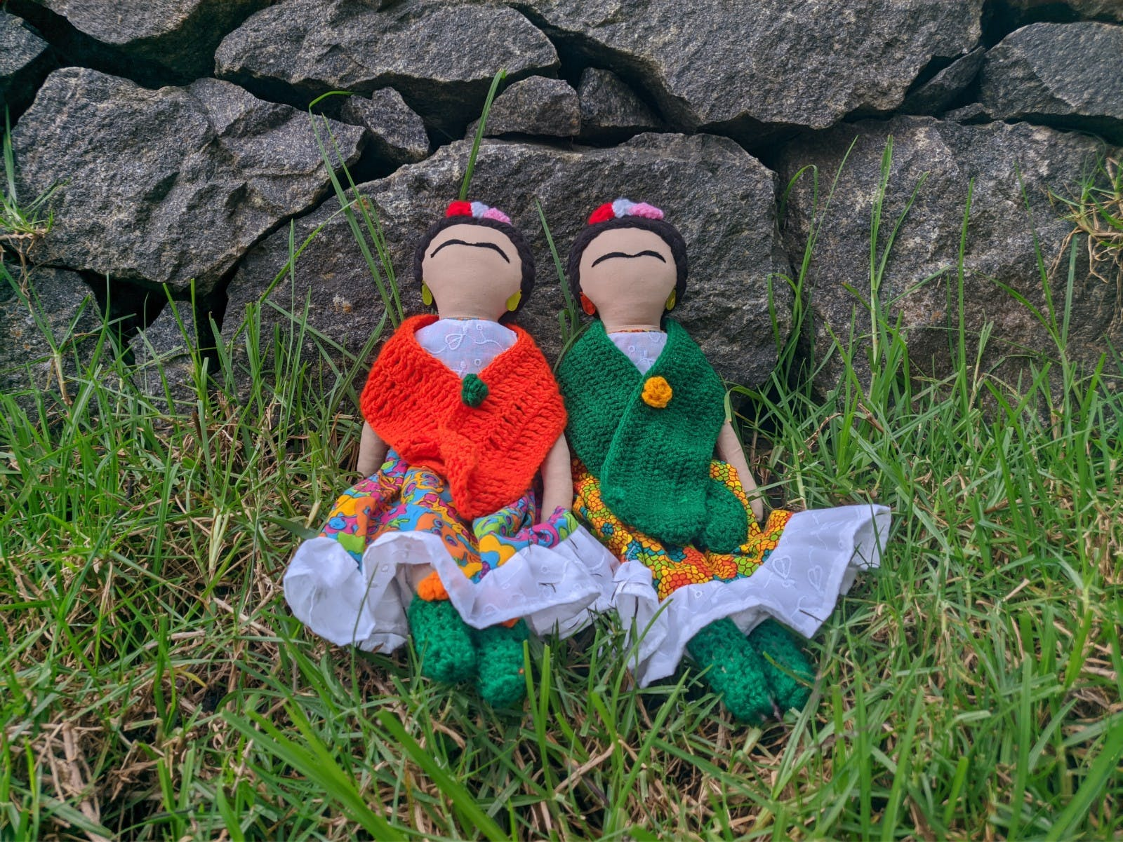 Head,Doll,Toy,People in nature,Grass,Plant,Groundcover,Lawn ornament,Grass family,Grassland