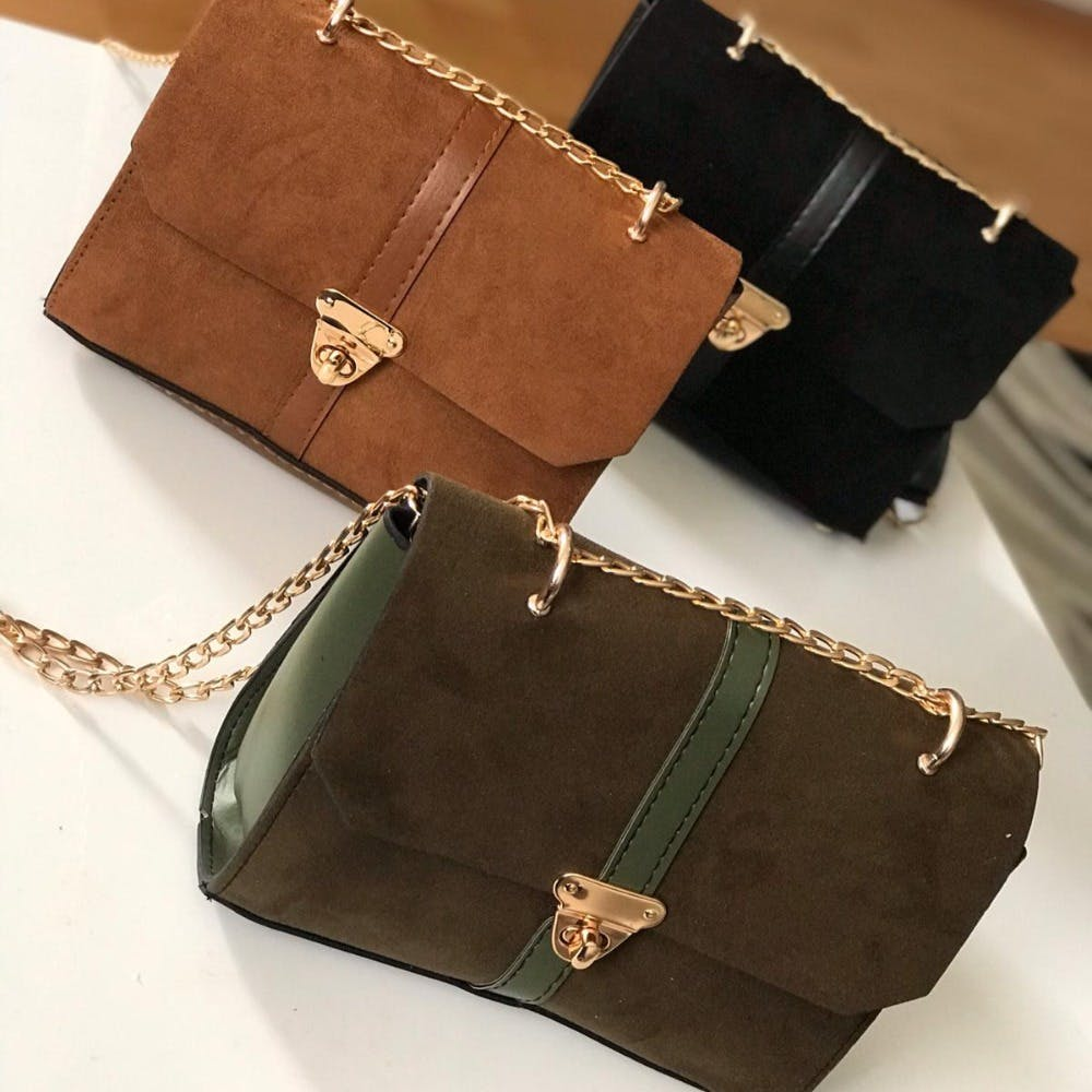 Brown,Luggage and bags,Bag,Rectangle,Amber,Shoulder bag,Gold,Material property,Beige,Font