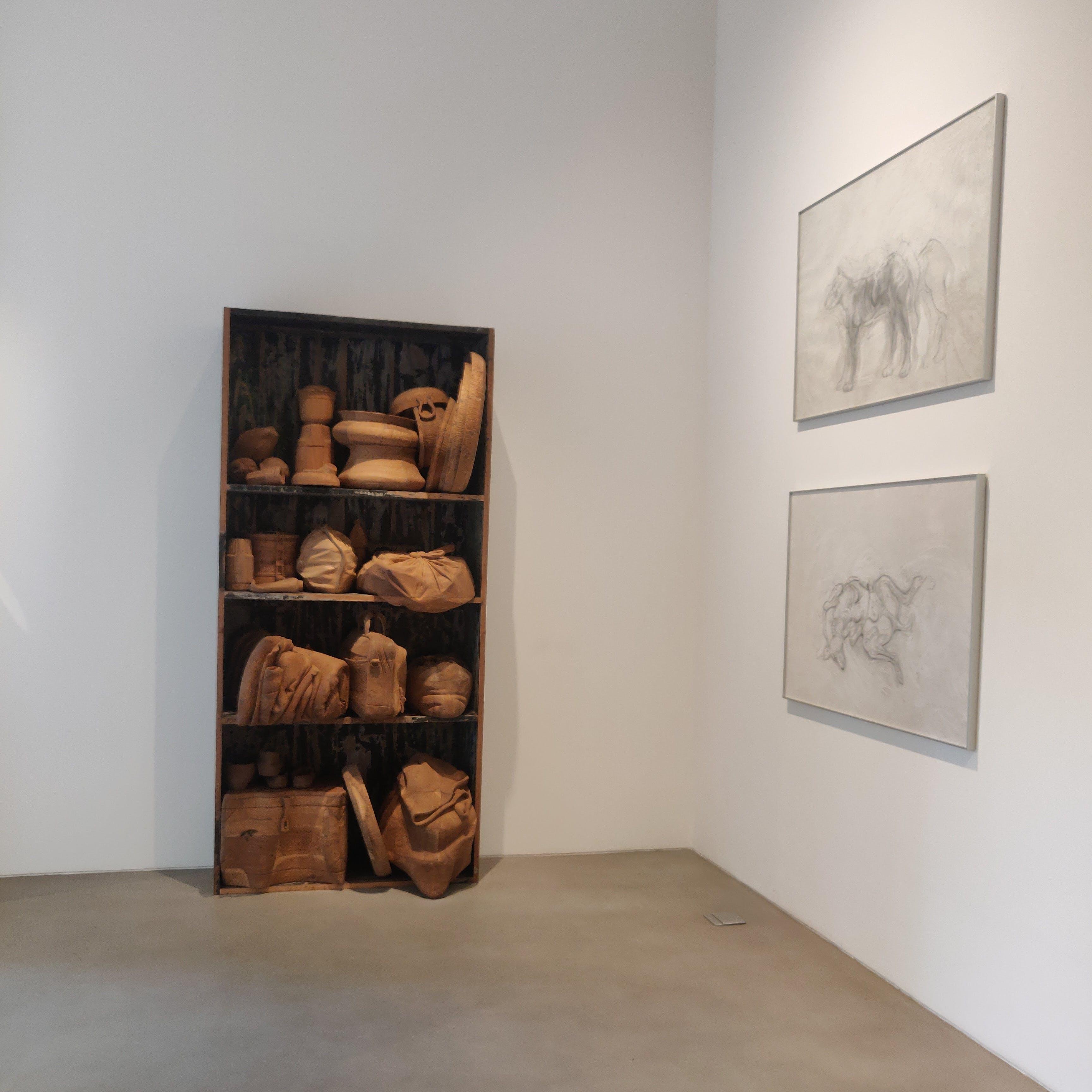 Picture frame,Sculpture,Wood,Grey,Art,Flooring,Rectangle,Hardwood,Artifact,Event