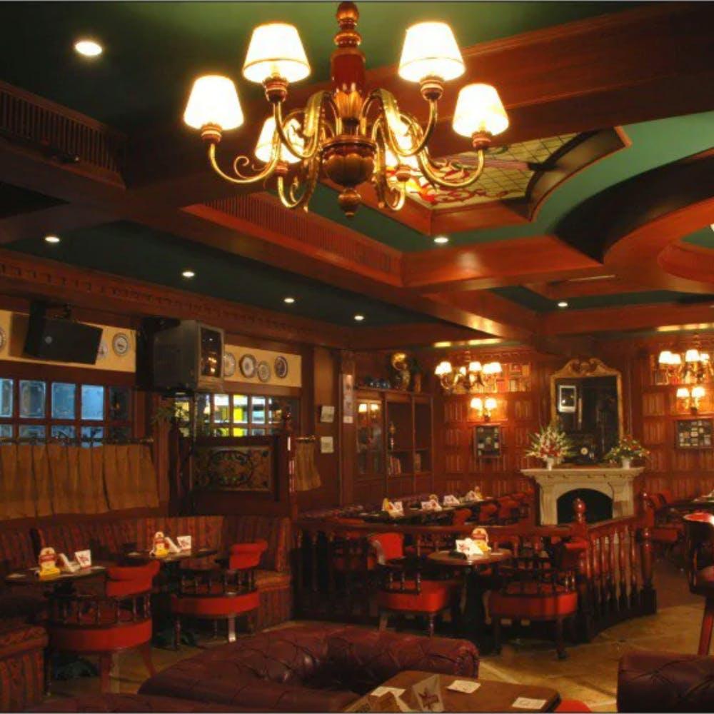 Light,Interior design,Lighting,Couch,Drinking establishment,Building,Chair,Table,Lamp,Barware