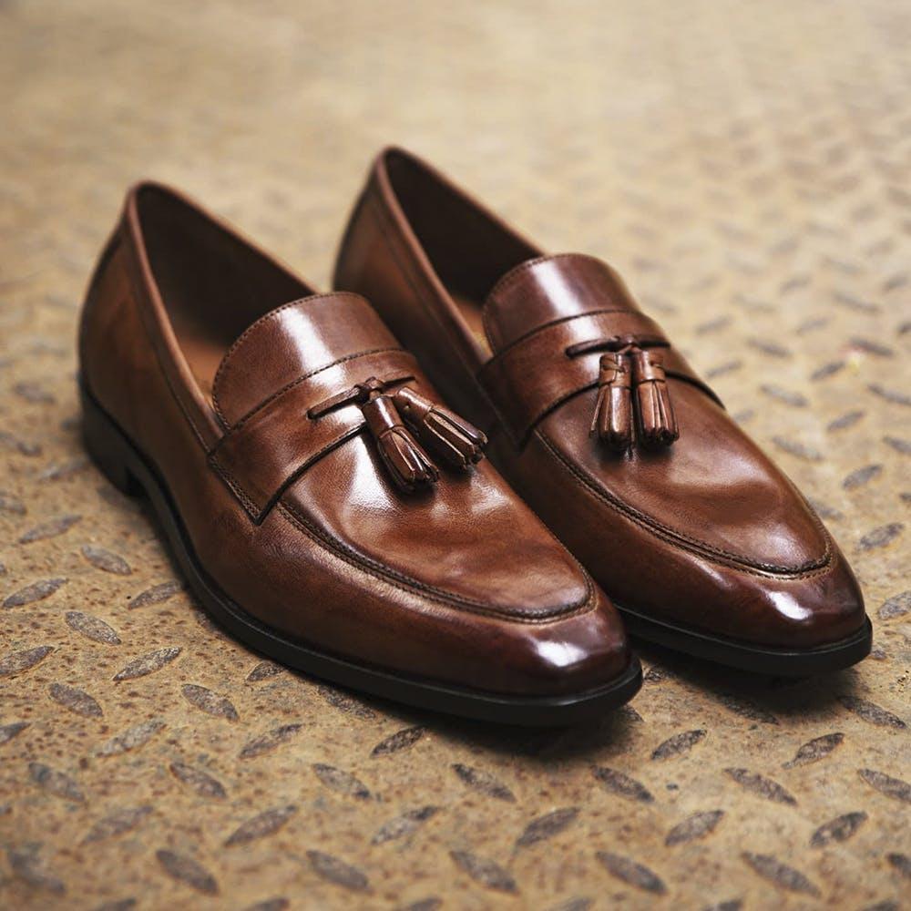 Brown,Dress shoe,Fashion design,Fashion accessory,Electric blue,Leather,Still life photography,Carmine
