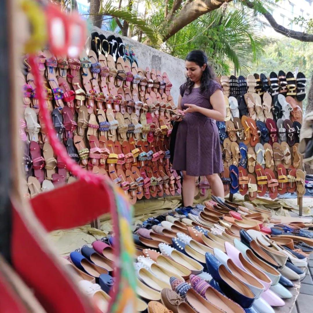 Selling,Eyewear,Textile,Dress,Street fashion,Market,City,Leisure,Shopping,Retail