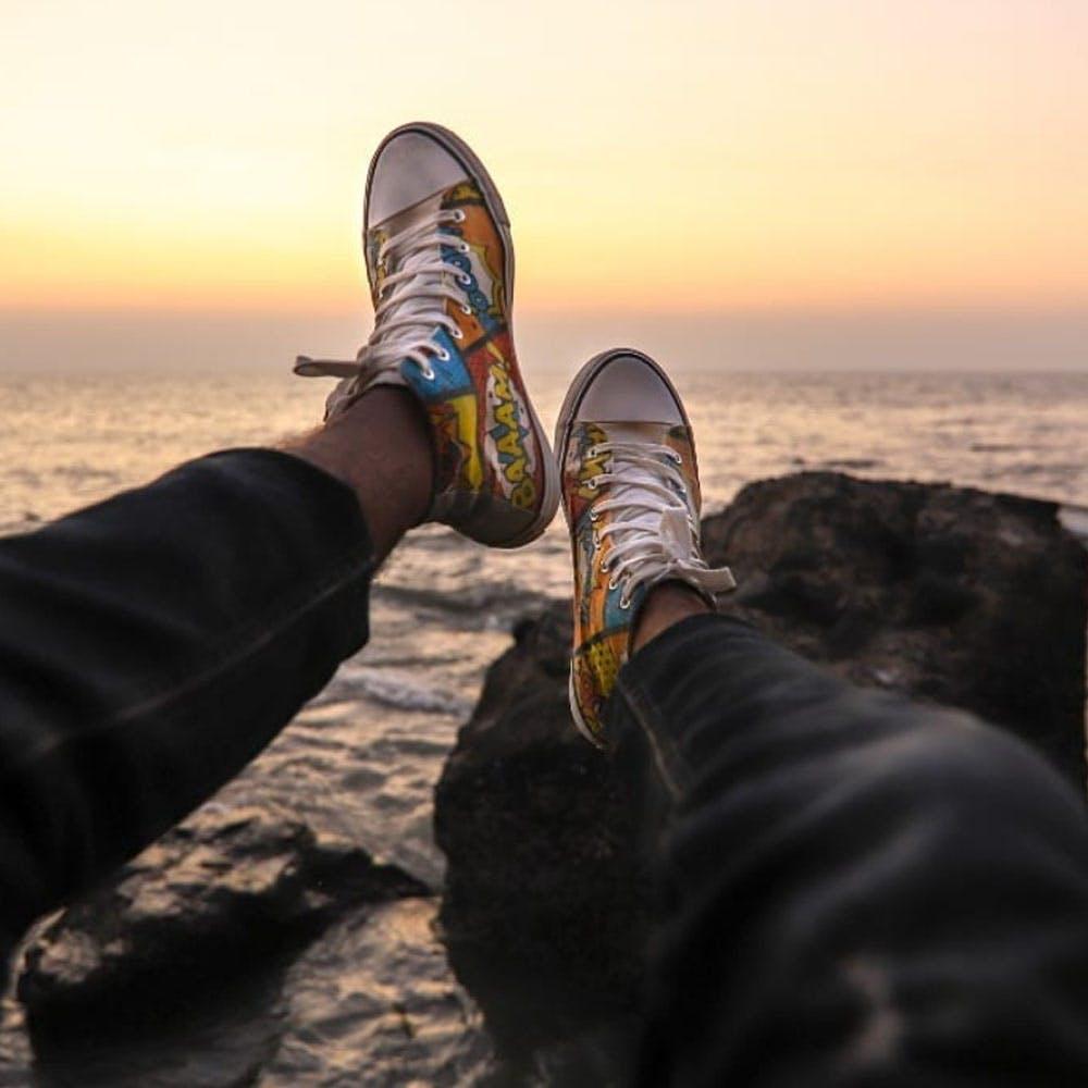 Water,Shoe,Sky,People in nature,Leg,Cloud,Sunlight,Body of water,Walking shoe,Sneakers