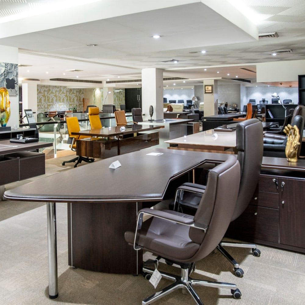 Furniture,Building,Office chair,Computer desk,Table,Chair,Desk,Automotive design,Interior design,Architecture