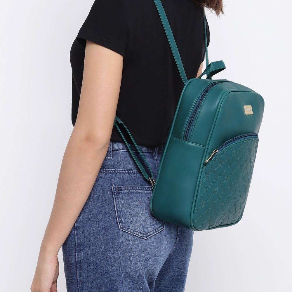 Hand,Arm,Luggage and bags,Product,Azure,Neck,Sleeve,Waist,Bag,Street fashion