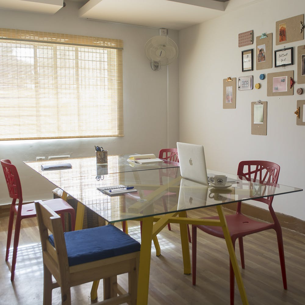 Table,Furniture,Picture frame,Chair,Window,Building,Wood,House,Laptop,Interior design