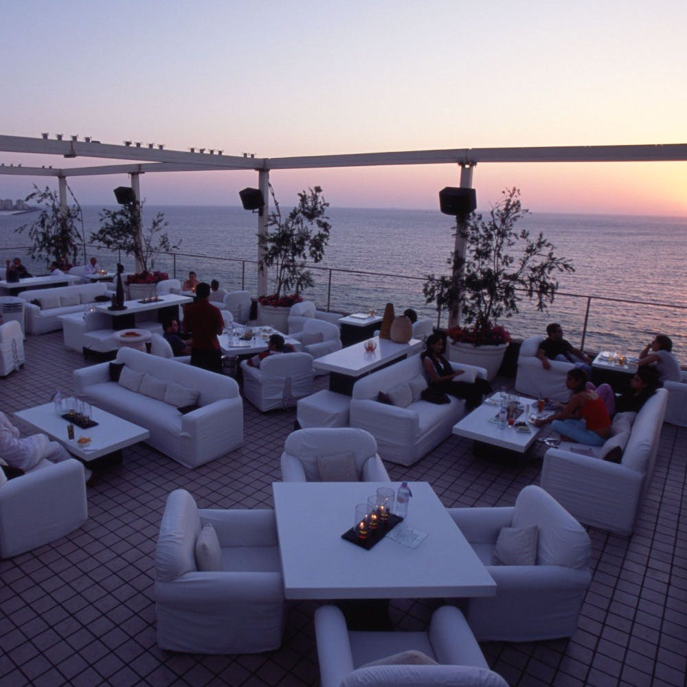 Water,Sky,Property,Furniture,Couch,Table,Azure,Outdoor furniture,Interior design,Shade