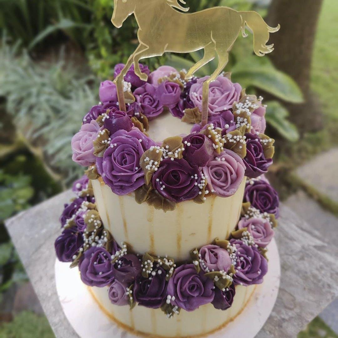 Flower,Food,Cake decorating,Cake,Purple,Petal,Horse,Cake decorating supply,Plant,Ingredient
