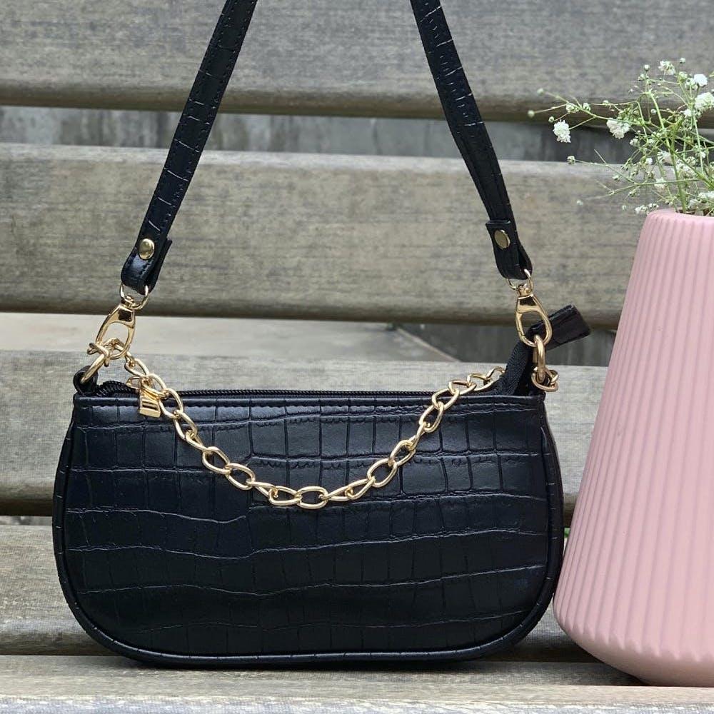 Brown,Luggage and bags,Bag,Beige,Handbag,Shoulder bag,Plant,Grey,Font,Rectangle
