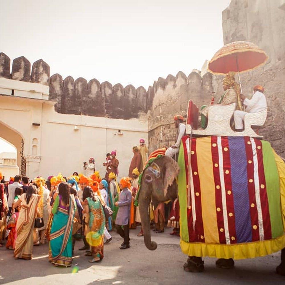 Temple,Hat,Headgear,Membranophone,Sky,People,Event,Musical instrument,Dance,Landscape