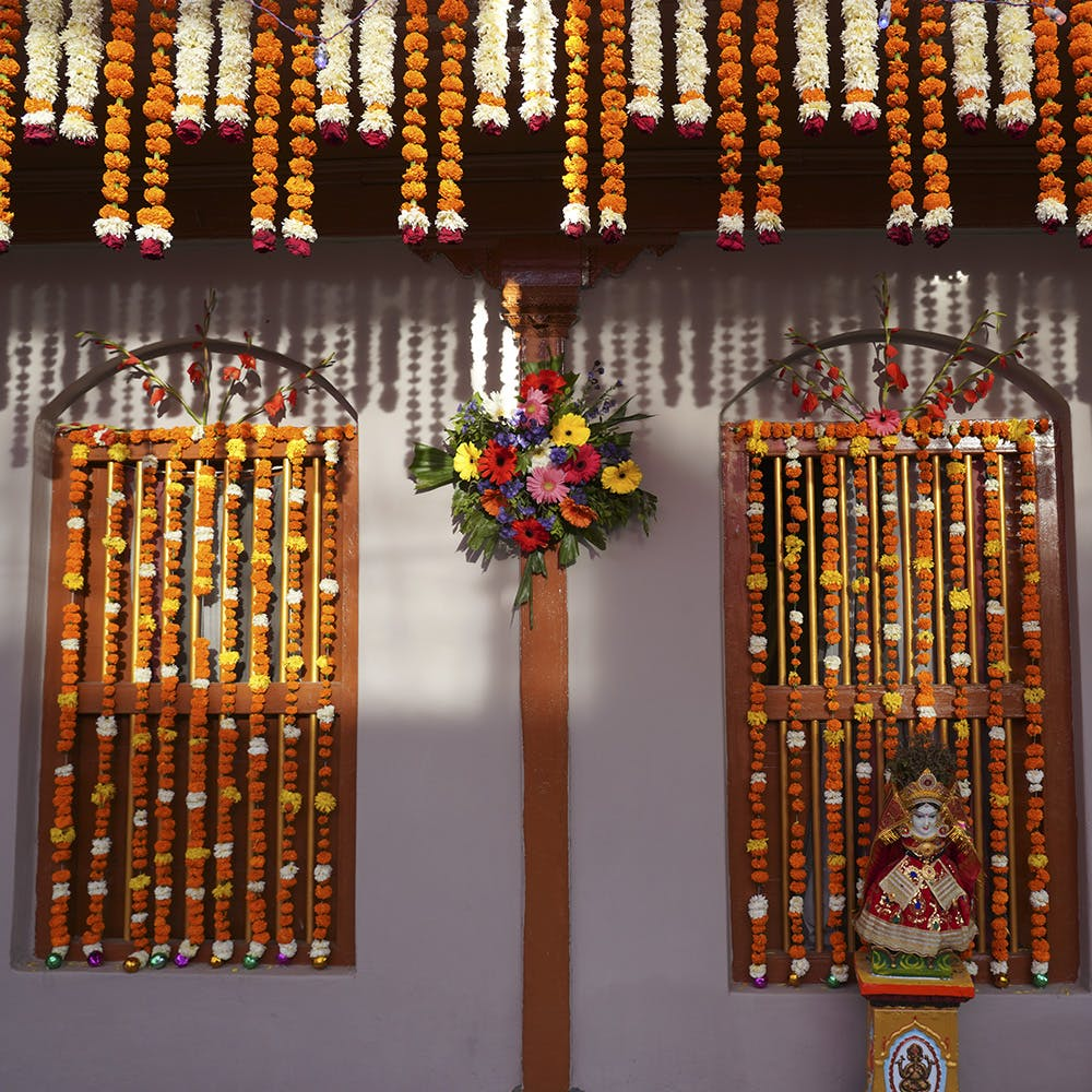Flower,Product,Amber,Gold,Event,Religious item,Art,Wood,Place of worship,Temple