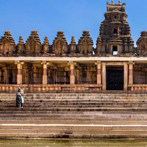 Sky,Temple,Temple,Facade,Archaeological site,Finial,Hindu temple,Ancient history,Symmetry,Monument